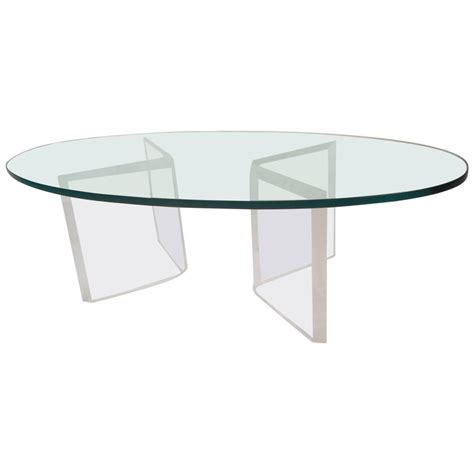 There are 363 suppliers who sells. Mid-Century Modern Oval Glass and Lucite Coffee Table at 1stdibs
