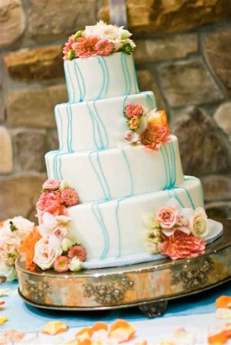wedding cake  coral colored flowers wedding stuff