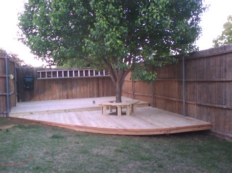 6 treated pine deck with bench around tree fences