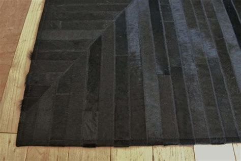 Cowhide Patchwork Rugs Australia by Awesome Black Rug In Leather Cowhide