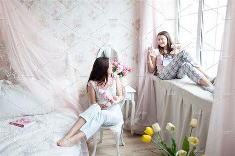 mother  daughter  light bedroom people