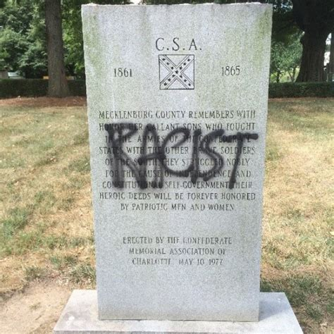 racist  confederate monuments defaced  charlotte