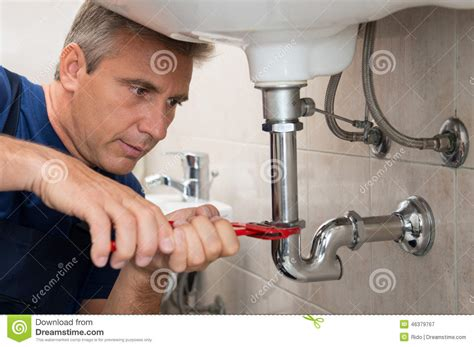 fixing kitchen sink plumber teaching apprentice to fix kitchen sink stock 3764