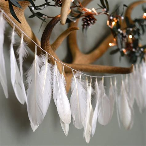 white feather garland   forest