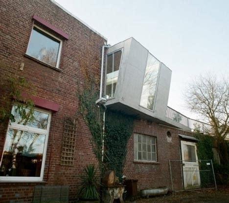 concrete cantilever small brick home  story box