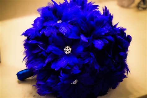 cobalt blue feather bridal bouquet onewedcom