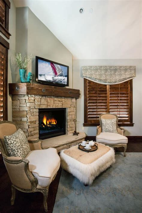 cozy master sitting area features stone fireplace hgtv