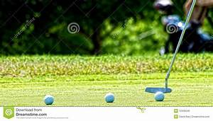 Putting Golf Ball Into Hole Stock Photo - Image: 12435540