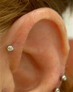 Triple Forward Helix Piercing On Left Ear