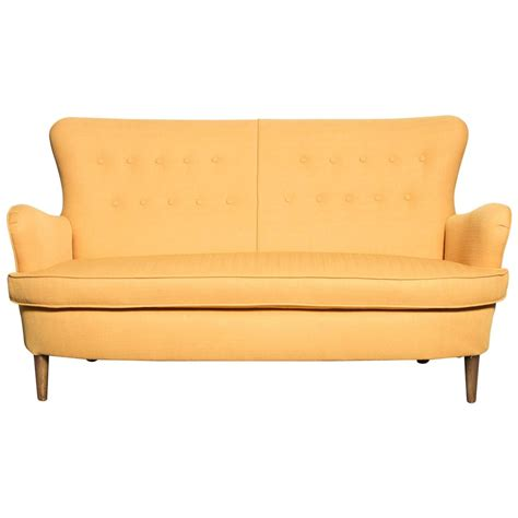Wingback Loveseat by Theo Ruth Style Wingback Loveseat In Yellow For