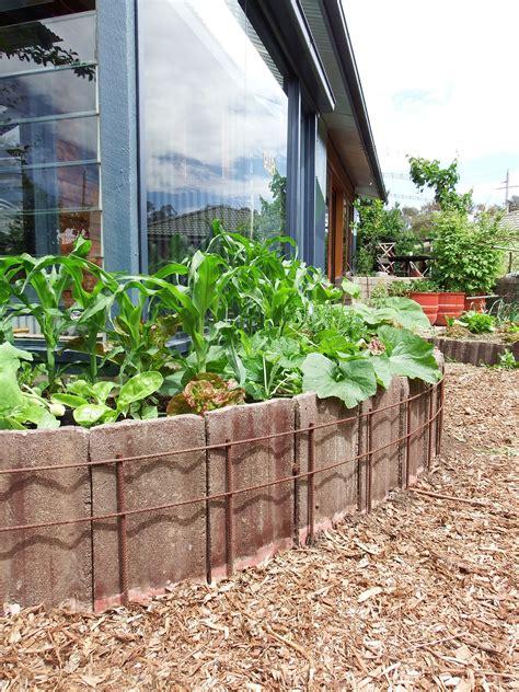 garden to make raising garden beds using concrete roof tiles