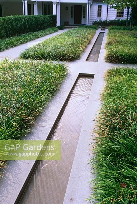 gap gardens contemporary water rill  grasses paths