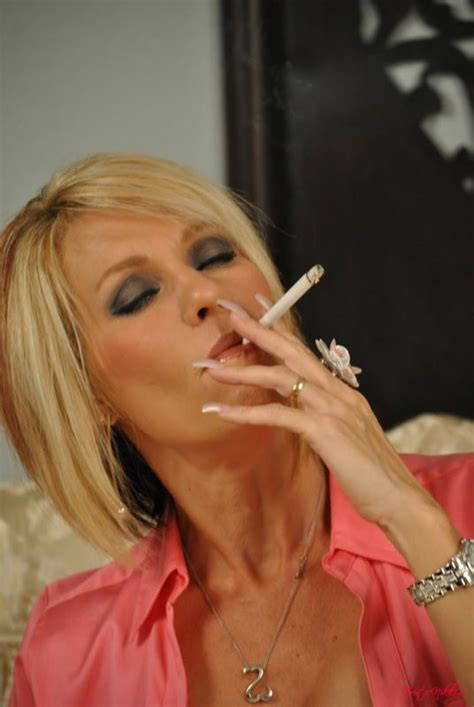 Stunning Blonde Lady Smoking A Cigarette And Touching Herself