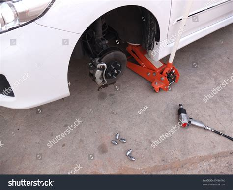 Car Without Tire At Jack In Service Stock Photo 99086960