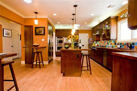 eye catching orange kitchen design with colorful ceramic