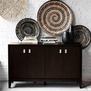 Modern wall decoration with ethnic wicker plates bowls