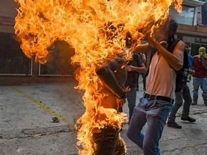 Venezuela unrest: Protester catches fire as death toll ...