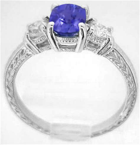 Tanzanite And Diamond Ring With Engraved Band In 14k White. Exotic Engagement Rings. Senior Rings. Johan Wedding Rings. Tv Show Engagement Rings. Diana Engagement Rings. Daisy Flower Engagement Rings. Mens Victorian Rings. Round Rings