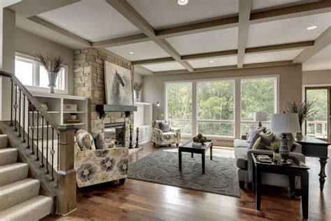 great room  coffered ceiling open floor plan great bow window small picture windows