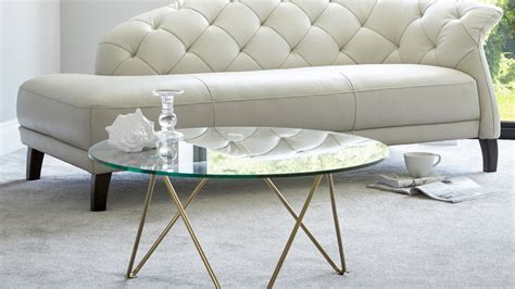 The most common glass gold coffee table round material is glass. Round Glass + Gold Coffee Table - Glass + Brass Coffee Table