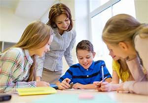 Group Of School Kids Writing Test In Classroom Stock Photo ...