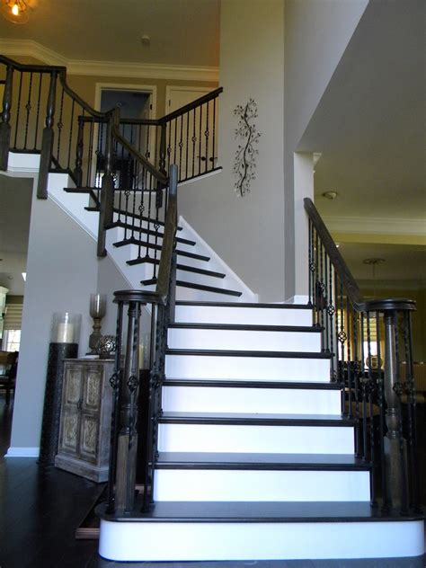 wood banisters wood stairs and rails and iron balusters
