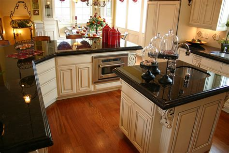 white cabinets with black granite the granite gurus absolute black granite kitchen
