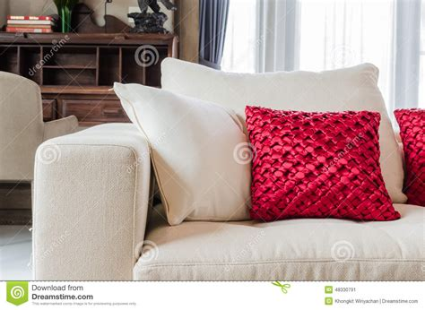 red and white sofa red and white pillow on white sofa at home stock image