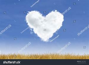 Blue Sky And Heart Shaped Cloud Over Yellow Grass Stock ...