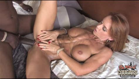 Redhead Milf Is Sucking A Tasty Interracial Snake In The Bedroom