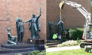 statue  missionary preaching  native americans moved