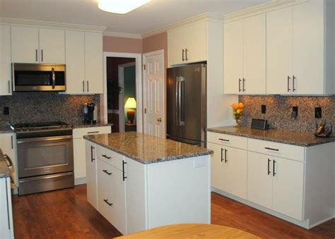 laminate flooring cabinets caledonia granite tops and backsplash white quot rohe quot cabinets laminate floors kitchen other