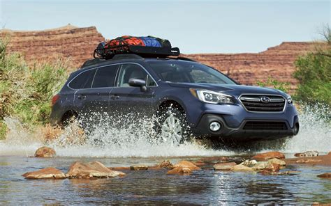 comparison subaru outback  limited   jeep