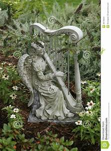 Garden Statue Of An Angel Playing A Harp Stock Photo