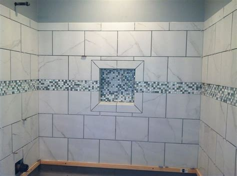 white shower tile shoo box shower niche with mosaic