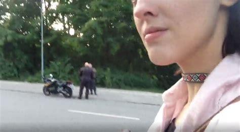 girl secretly filming motorists faceplants  pole