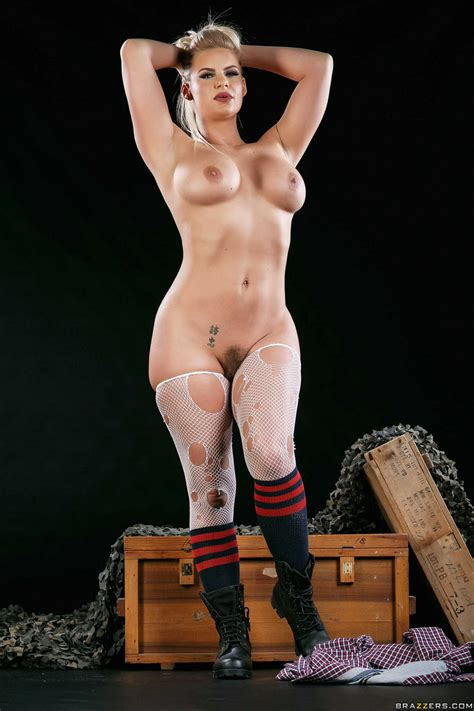 Phoenix Marie in shirt and stockings strips in front of ...
