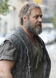 Russell Crowe shows off grey beard and scruffy new look as ...