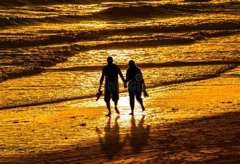 couple walking  beach stock image image  bare walk