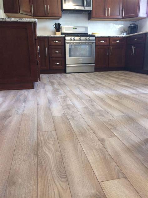 kitchen flooring ideas  cherry cabinets