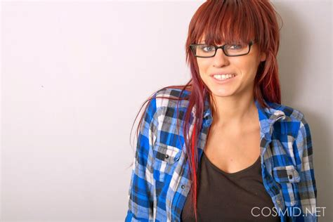 Hot redhead nerd exposes her natural melons in glasses and