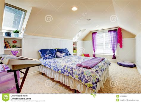 Girl Bedroom With Attic Ceiling And Beige Carpet With Toys