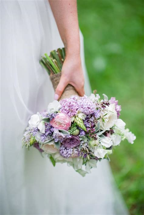 A Romantic Spring Bridal Bouquet In Purple And Pink Chic