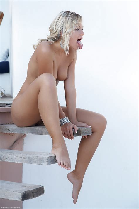 Legs Open And Pretty Shaved Pussy Is Shown As The Blonde