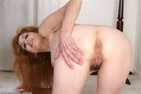 Foxy red headed milf spreading her tasty mature hairy ...