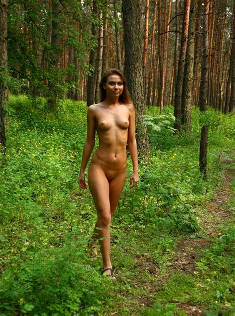 Skinny Naked Chick Nida Takes A Walk In The Woods And