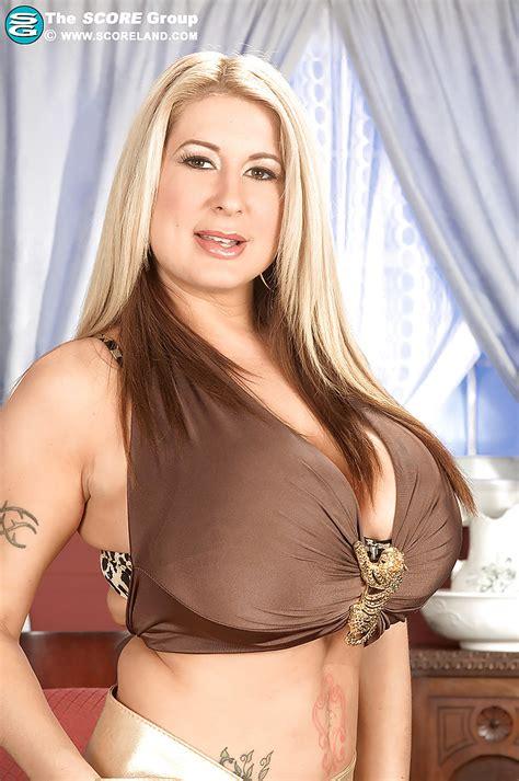Busty Blond Summer Sinn Denudes Her Huge Round Boobs And