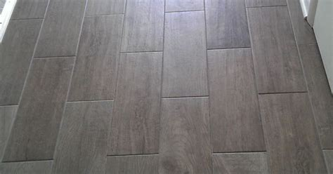 floor for all bathrooms except level dal tile emblem