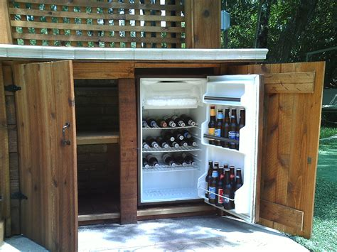 custom outdoor bar with refrigerator