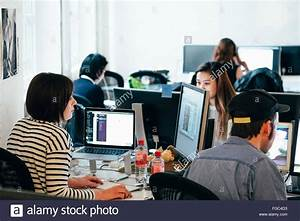 People Working On Computers At Office Stock Photo, Royalty ...